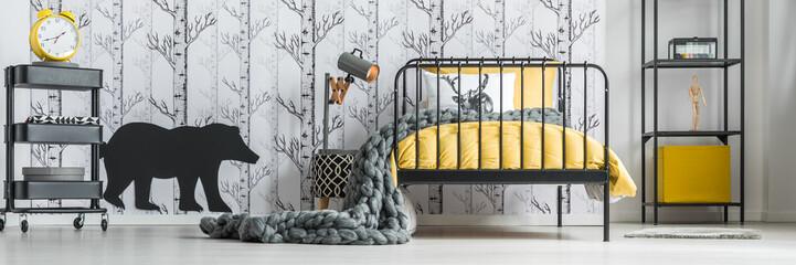 Child's bedroom with birch wallpaper