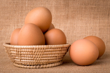 Eggs in a basket on  gunny (sackcloth)  background