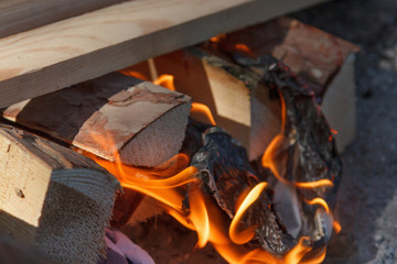 Glowing hot charcoal briquettes close-up background texture. bonfire