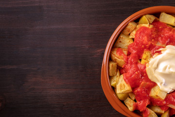 Patatas bravas, Spanish potato dish, overhead closeup shot