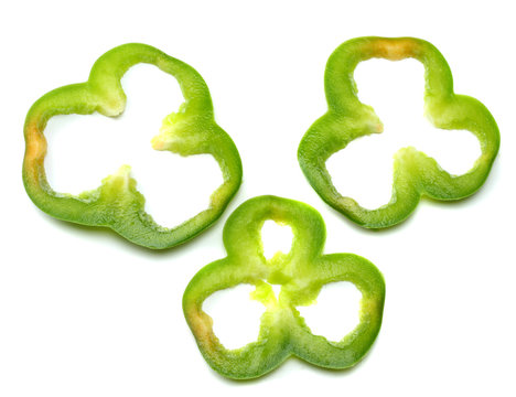 cut slices of green sweet bell pepper isolated on white background