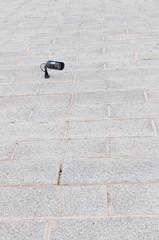 surveillance camera on a brick wall