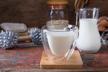 Milk cup on wooden on wooden background