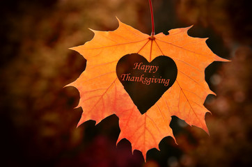 Thanksgiving card, with autumn leaves   background.