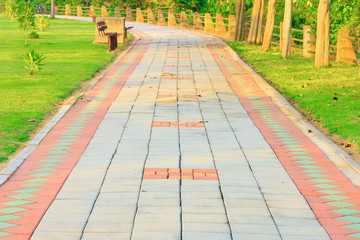 Stone block walk path in public park with sunset light tone with copy space add text ( high definition image )
