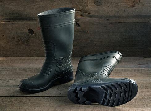 Men's rubber boots on the wooden floor