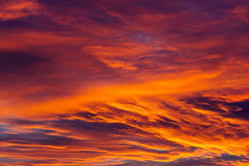 Amazing sky background with clouds in sunrise.