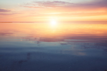 Scenic ocean sunset over the calm water surface