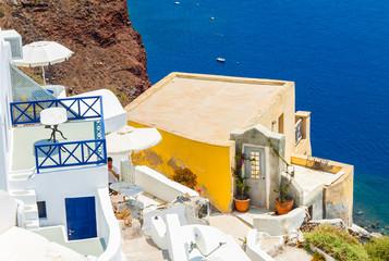 Nice yellow house with a seaview in Oia on Santorini island, Greece