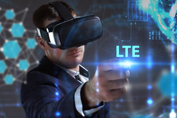 Foto op Canvas Surrealisme Business, Technology, Internet and network concept. Young businessman working in virtual reality glasses sees the inscription: LTE