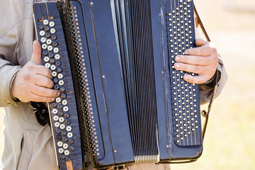 musician plays the old accordion
