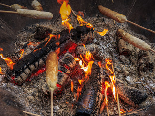 Stockbrot, fresh bread around a stick over the fire