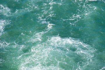 Wavy emerald ocean surface from above