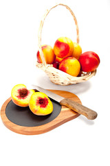 Freshly washed peach  on wooden cutting board with knife