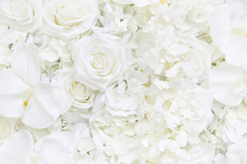 Decoration artificial white roses flower bouquet as a floral wallpaper with soft focus and copy space. White rose and orchid petals background for valentines day or wedding ceremony.