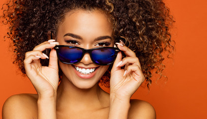 49c04e5d1b0 Portrait of smiling black girl with sunglasses