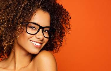 Portrait of black woman with glasses and smiling