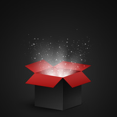 Black and red open box with magical dust and luminous white particles on a dark background. Abstract white lights. Vector
