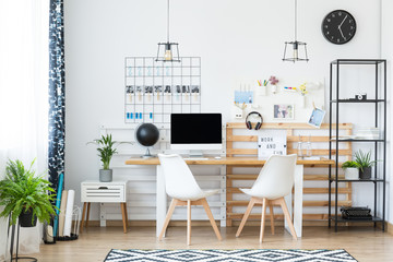 Monochromatic home office with photos