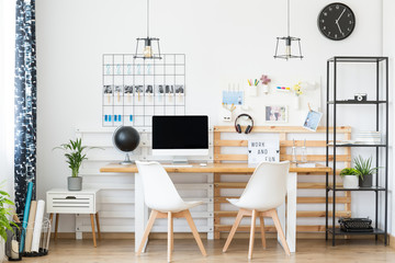 Simple workspace with wooden table