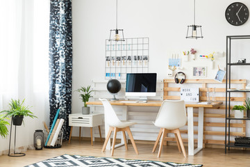 Home office with white chairs