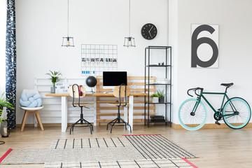 Black bike in home office