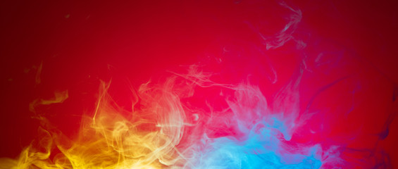 yellow and blue smoke on red background