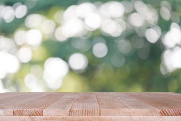 Wood table top on bokeh green background - can be used for montage or display your products