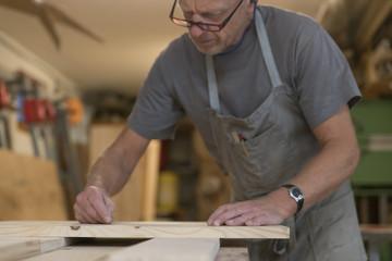 Carpenter working in workshop