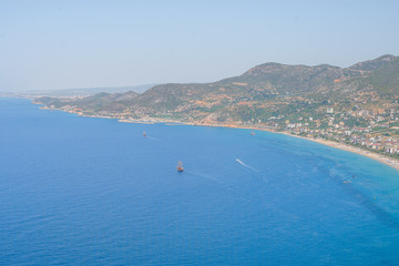 View from the mountain to the sea bay with blue water and ships