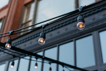 Ornamental light bulbs in front of a building