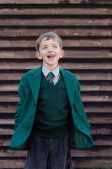Cheeky school boy in his uniform