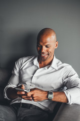 African American Businessman Typing on the Phone