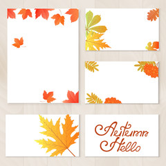 A set of cards with yellowed leaves, berries of mountain ash. Hand lettering Hello Autumn. Template for a voucher, banner, discount, seasonal sale