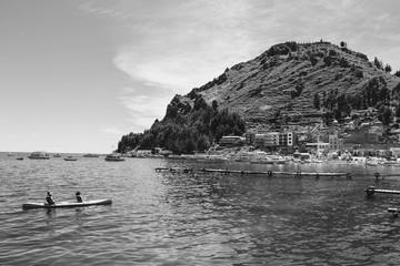 boat sailing through the lake in la paz, bolivia