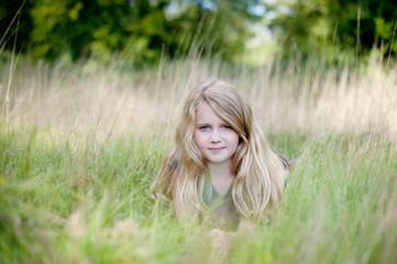 Girl laying in long grass
