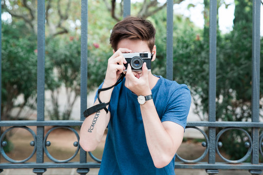 Man taking pictures with a vintage camera
