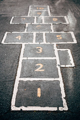 Numbered Hopscotch Squares On School Asphalt Playground