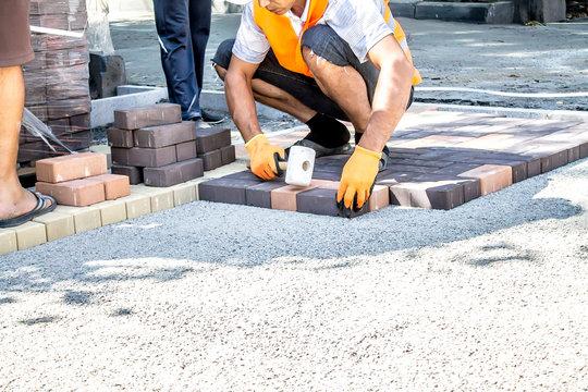 Work on laying paving slabs