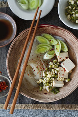 Asian noodle soup with smoked tofu and leeks