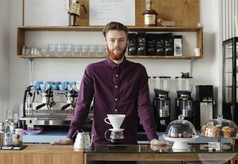 Portait of a barista inside a modern coffee shop.