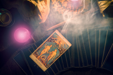 Tarot card / View of tarot card on the table under candlelight. The Lover. Dark tone.