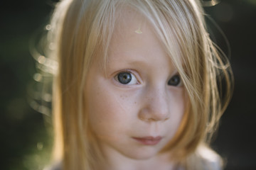 Innocent Close up Portrait of a little girl with blonde hair