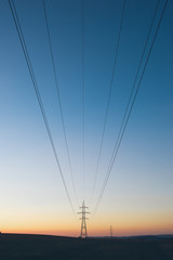 High-voltage lines crossing the sky
