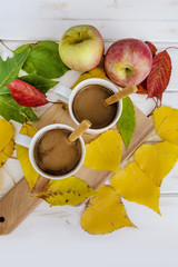 Autumn fall leaves and two cups of coffee.Morning coffee.Still life concept.