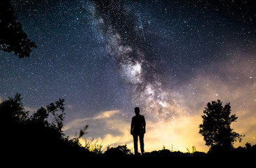 Man standing deep sky in germany