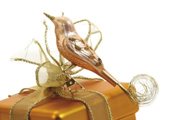 Copper bird Christmas ornament on wrapped present