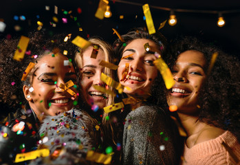 Close up shot of four young women making selfie under confetti