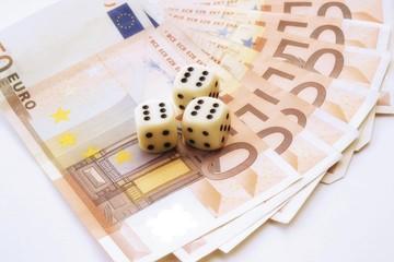 Dice on fan of euro-bills