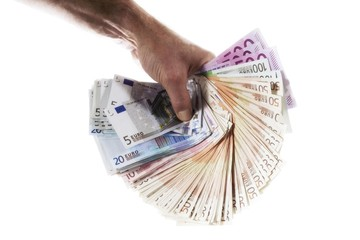 Hand holding fanned-out cash, Euros